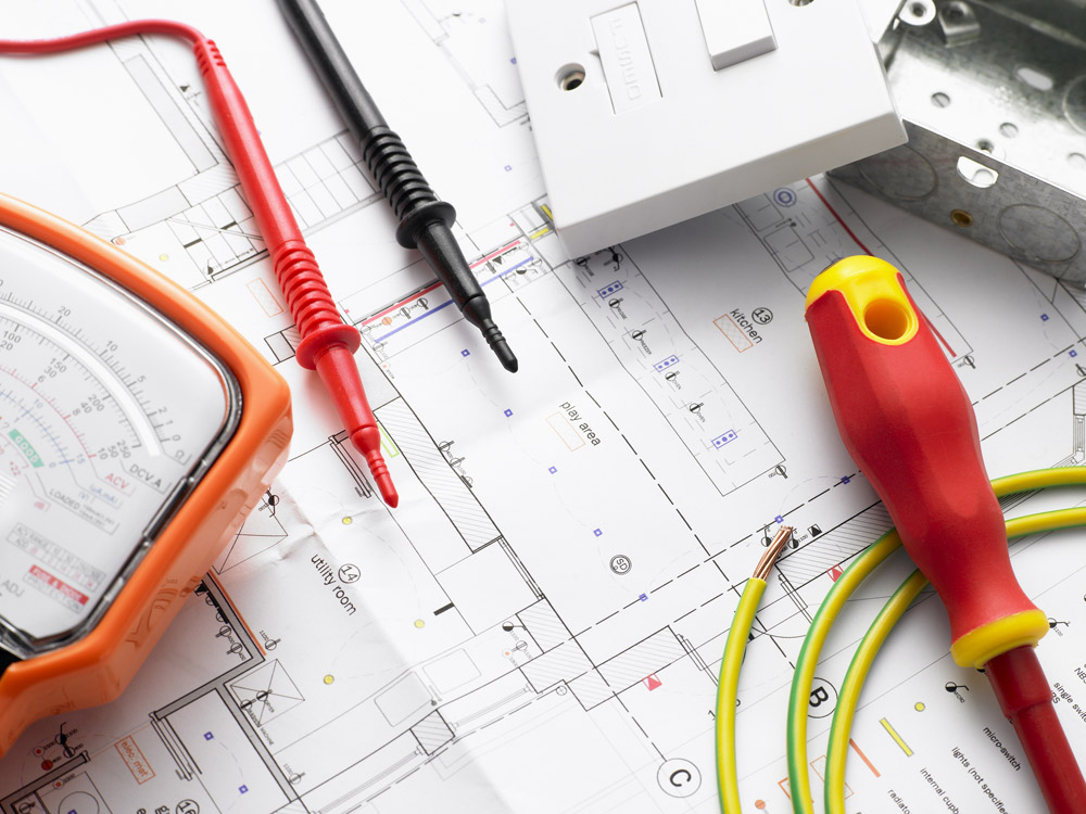 electrian's tools on electrical house plans
